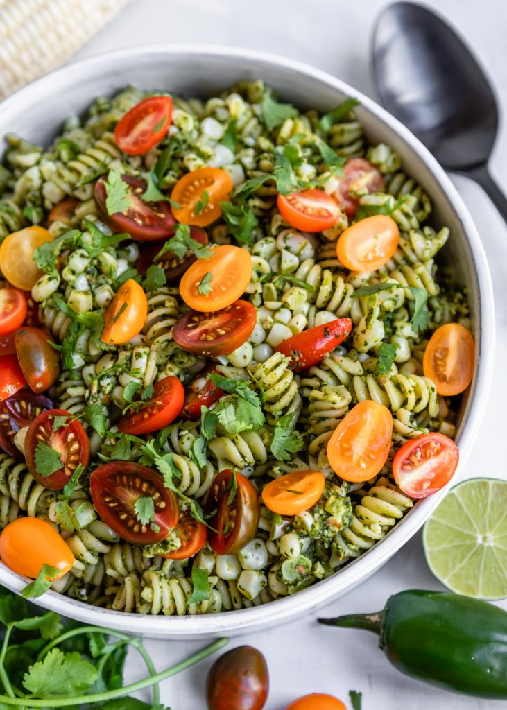 Jalepeno Cilantro Pesto Rotini with Corn and Grape Tomatoes | HelloVeggie.co